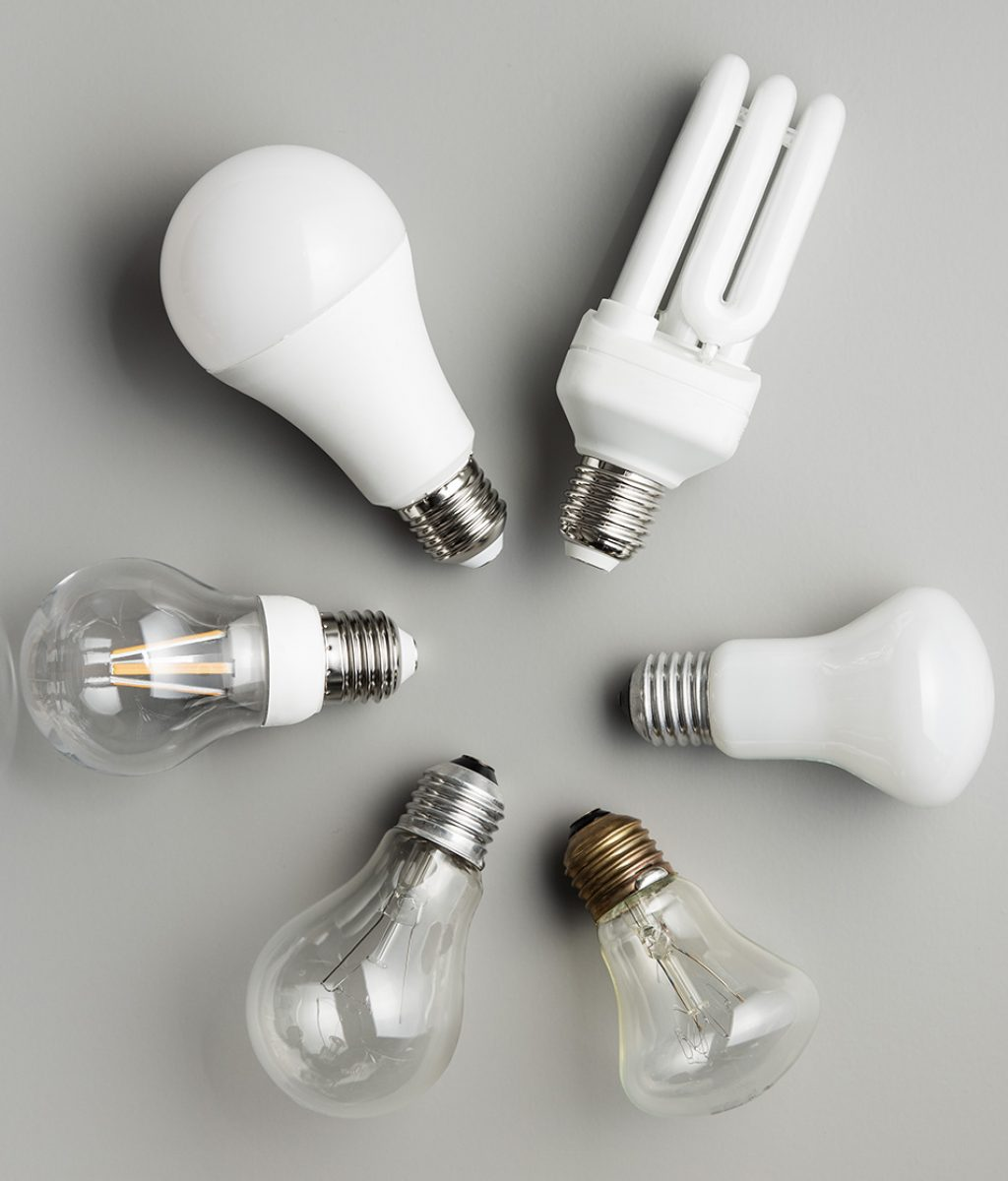 Energy saving and classic light bulbs on gray background. Top view.